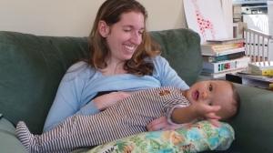 Ezra smiles while nursing